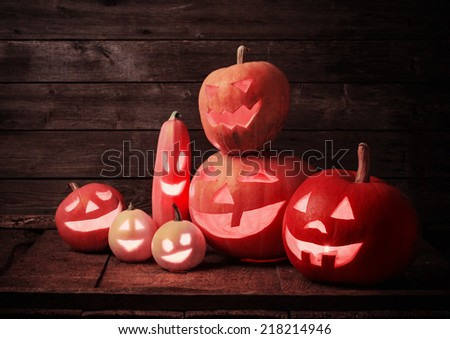 Halloween pumpkins on wooden background  - stock photo