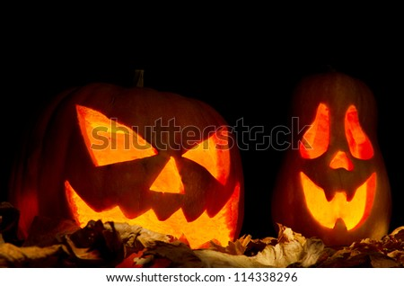 Halloween pumpkins over dried leaves