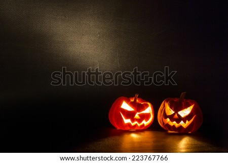 Halloween pumpkins smile and scrary eyes for party night - stock photo