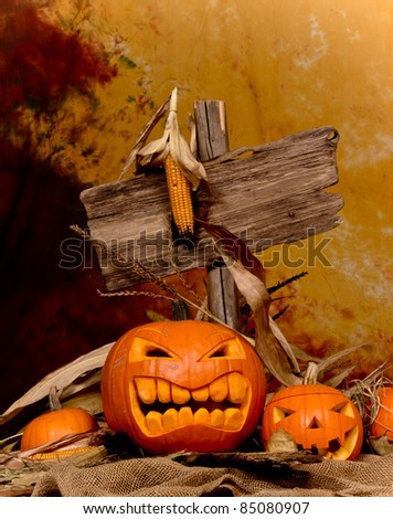 Halloween pumpkins with wooden sign - stock photo