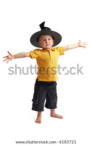 Halloween scarecrow. Very cute 3 years old boy in witch hat isolated on white background