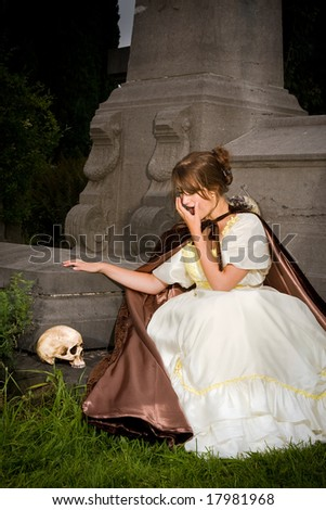 Halloween scene of a victorian woman seeing a skull - stock photo