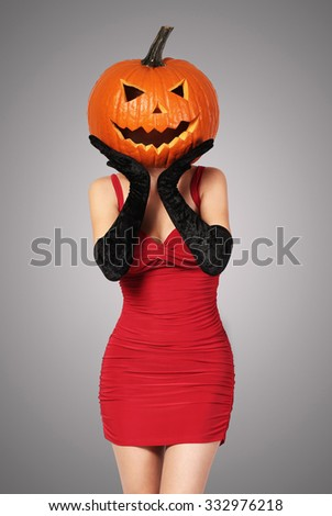 Sexy Lady In Red With Big Pumpkin On Head