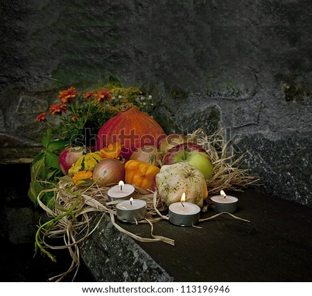 halloween still life with pumpkins and candles in the night time - stock photo