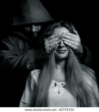 Halloween surprise - evil man behind innocent naive girl - stock photo
