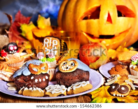 Halloween table with trick or treat. Carving pumpkin - stock photo