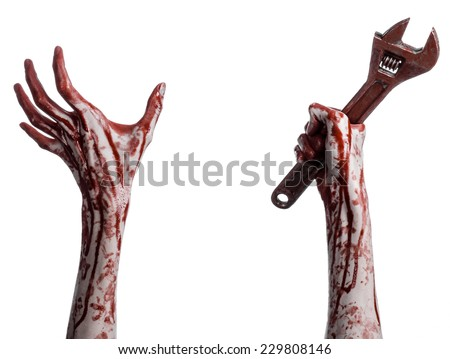 Halloween theme: bloody hand holding a big wrench on a white background - stock photo