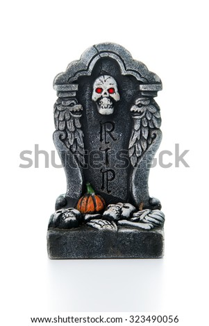 Halloween theme with RIP tombstone on white background - stock photo