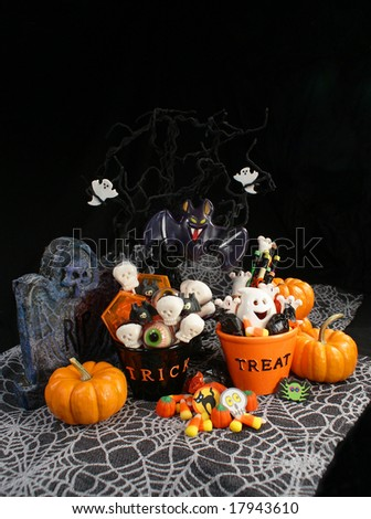 Halloween Trick or Treat Bowls Full of Candy and Treats - stock photo