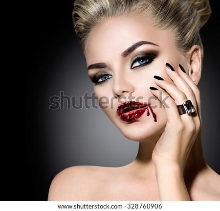 Halloween Vampire Woman make up. Beautiful sexy girl with Vampire makeup, black nails and and accessories