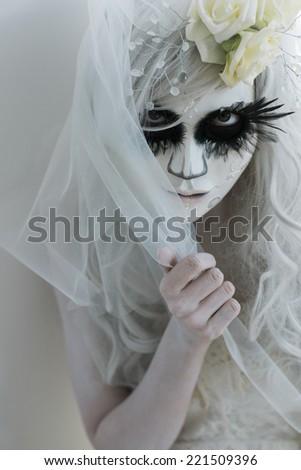 Beautiful Woman Wearing Santa Muerte Mask And Wedding Dress