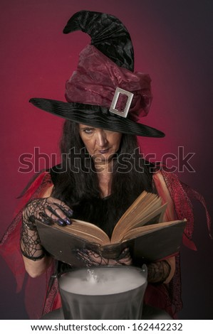 Halloween witch casting spells, with cauldron on dark background