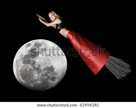Halloween witch flying on a broomstick at night. - stock photo