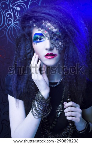 Halloween. Young woman with artistic visage