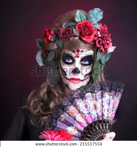 Halloween. Young woman with artistic visage and with roses in her hair/ - stock photo