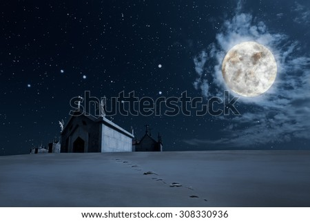Hallowen background with footprints in the foreground towards a cemetery in a clear starry full moon night - stock photo