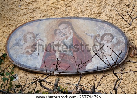HALLSTATT, AUSTRIA - DECEMBER 13: Virgin Mary with baby Jesus painting on house facade on December 13, 2014 in Hallstatt, Austria. - stock photo