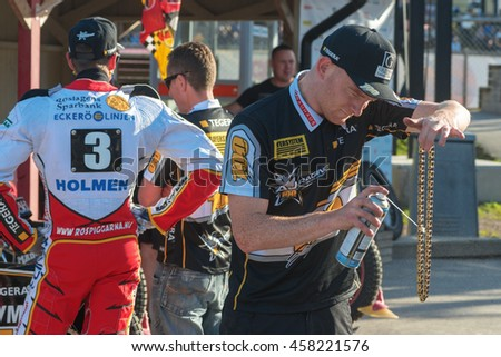 HALLSTAVIK, SWEDEN - JULY 19, 2016: Preparations of Andreas Jonsson bike at the speedway racing between Rospiggarna and Lejonen at HZ Bygg Arena in Hallstavik. - stock photo