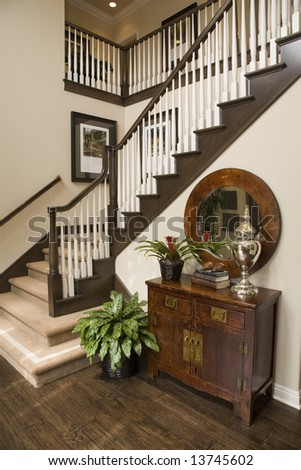 Hallway and staircase in a luxury home. - stock photo