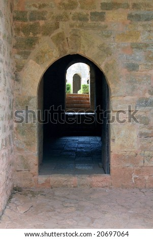 Hallway look through of an middle aged abbey. - stock photo