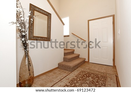 Hallway with tile floor and pottery