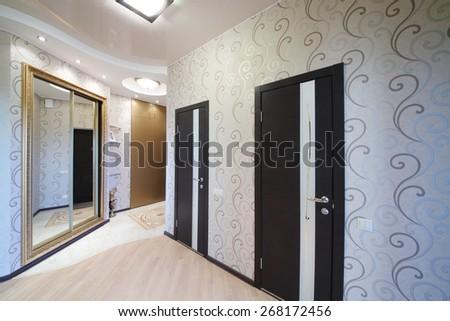 Hallway with two doors and sliding mirror wardrobe - stock photo