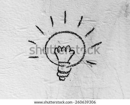 Halogen bulbs are written on the background black boards. - stock photo
