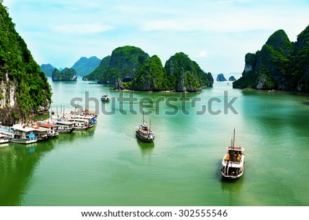 Halong, Quang Ninh, Vietnam - July 2, 2015: Boats of tourists on the Halong Bay. Halong Bay is the World's Natural heritage.