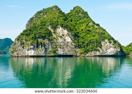 HALONG, VIETNAM - May 9, 2014 - Picturesque sea landscape with limestone mountains. Ha Long Bay,  Vietnam - stock photo