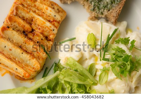 Haloumi, bread, potato salad and fresh salad