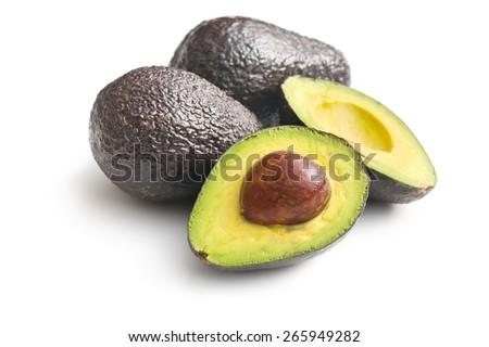halved avocado on white background - stock photo