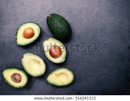 Halved avocados. Top view.  - stock photo
