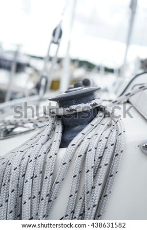 Halyard line wrapped around winch of sailboat