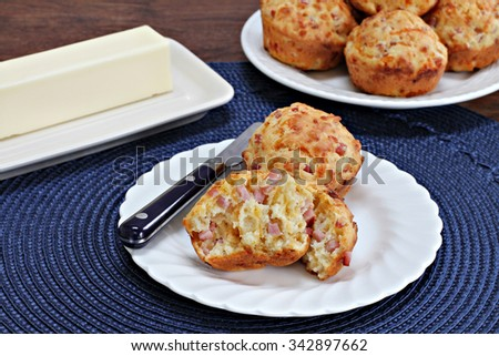 Ham and cheddar breakfast muffins, one open. - stock photo