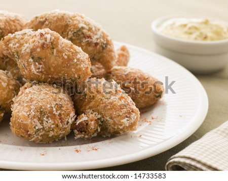 Ham and Cheese Beignets with Dijonnaise - stock photo
