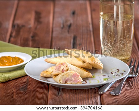 Ham and cheese empanadas, empanadas mixtas - stock photo