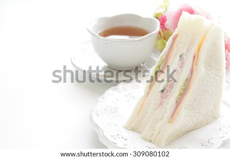 ham and cheese sandwich and english tea - stock photo
