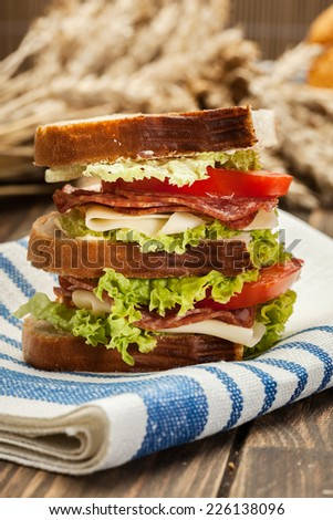 Ham and cheese sandwiches on a table - stock photo