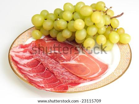ham and salami slice with grape - stock photo