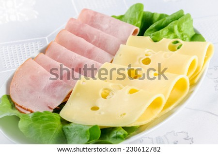 ham and yellow cheese with holes