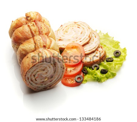 Ham decorated with tomatoes and salad over white background - stock photo