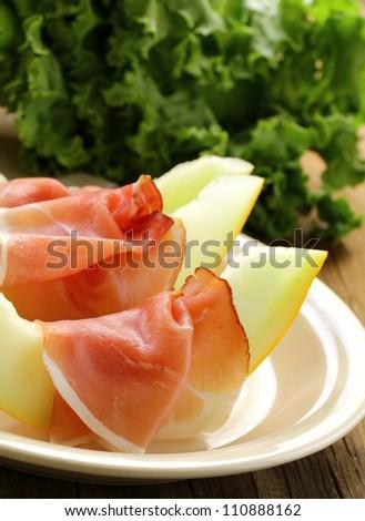 ham  Prosciutto with melon,   Italian appetizer - stock photo