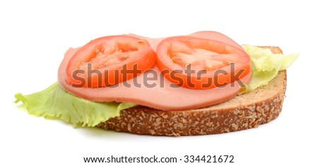 ham sandwich with lettuce and tomato on white background