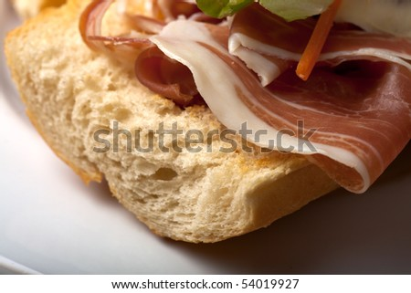 ham sandwich with salad leaves
