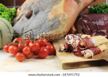 Ham slices of prosciutto di parma and san daniele for sandwiches and breakfast - stock photo