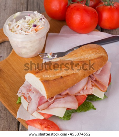 Ham sub sandwich made with cheese, tomato and lettuce
