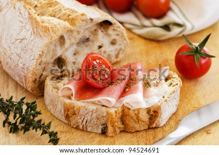 Ham with bread and tomatoes seasoned with herbs