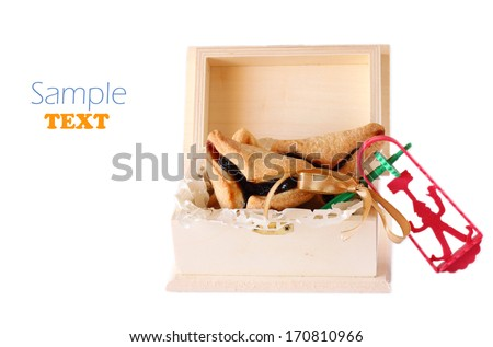 Hamantaschen cookies or hamans ears and noise maker for Purim celebration  - stock photo