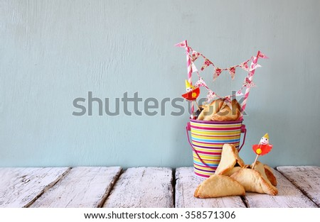 Hamantaschen cookies or hamans ears for Purim celebration (jewish carnival holiday) . selective focus  - stock photo