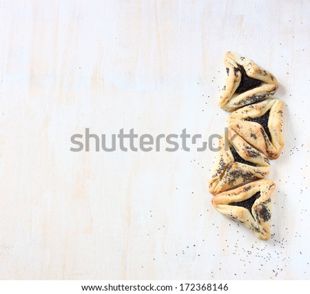 Hamantaschen cookies or hamans ears for Purim holiday celebration . top view. - stock photo